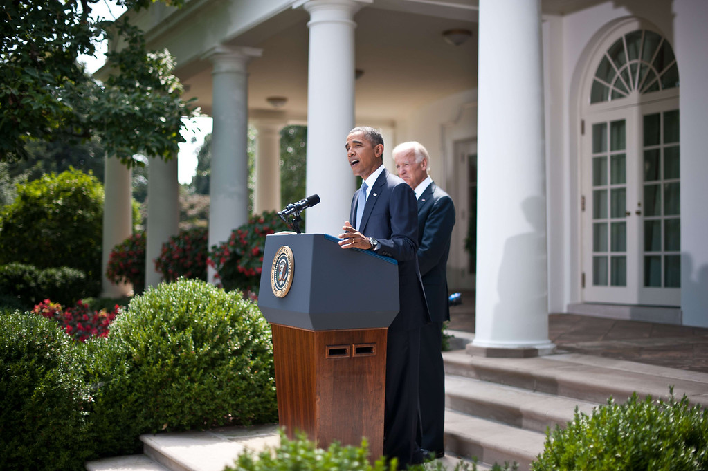 Description of . US President Barack Obama speaks on Syria in the Rose Garden at the White House in Washington on August 31, 2013 as Vice President Joe Biden looks on. Obama said Saturday he will ask the US Congress to authorize military action against Syria, lifting the threat of immediate strikes on President Bashar al-Assad's regime. Obama said he had decided he would go ahead and launch military action on Syria, but he believed it was important for American democracy to win the support of lawmakers. NICHOLAS KAMM/AFP/Getty Images
