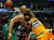 Denver Nuggets' Wilson Chandler (R) is blocked by Chicago Bulls' Carlos Boozer during the first half of their NBA basketball game in Chicago, Illinois, March 18, 2013.  REUTERS/Jim Young