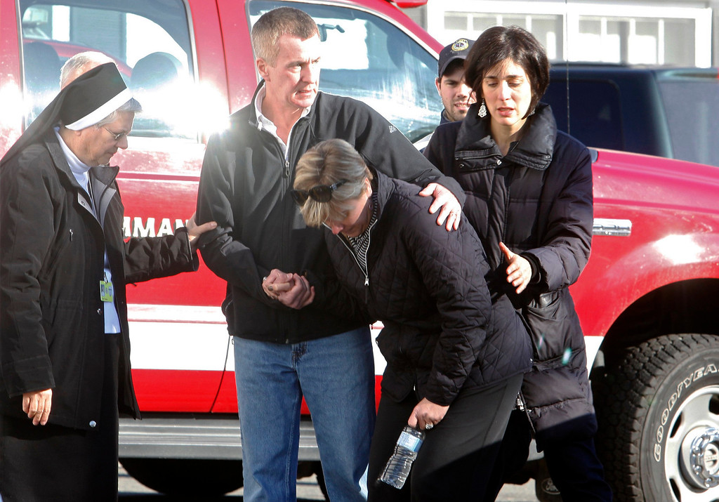Description of . Relatives react outside Sandy Hook Elementary School following a shooting in Newtown, Connecticut, December 14, 2012. At least 27 people, including 18 children, were killed on Friday when at least one shooter opened fire at an elementary school in Newtown, Connecticut, CBS News reported, citing unnamed officials.  REUTERS/Michelle McLoughlin