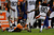 Denver Broncos free safety Jim Leonhard (36) with a one handed tackle on Cleveland Browns wide receiver Travis Benjamin (80) during the fourth quarter. The Denver Broncos vs Cleveland Browns at Sports Authority Field Sunday December 23, 2012. Tim Rasmussen, The Denver Post