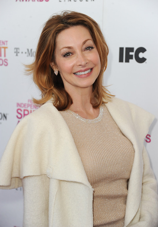 Description of . SANTA MONICA, CA - FEBRUARY 23:  Actress Sharon Lawrence attends the 2013 Film Independent Spirit Awards at Santa Monica Beach on February 23, 2013 in Santa Monica, California.  (Photo by Kevin Winter/Getty Images)