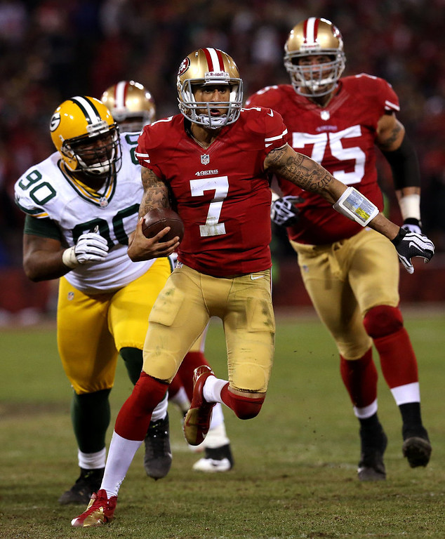 . Quarterback Colin Kaepernick #7 of the San Francisco 49ers runs the ball against nose tackle B.J. Raji #90 of the Green Bay Packers during the NFC Divisional Playoff Game at Candlestick Park on January 12, 2013 in San Francisco, California.  (Photo by Stephen Dunn/Getty Images)