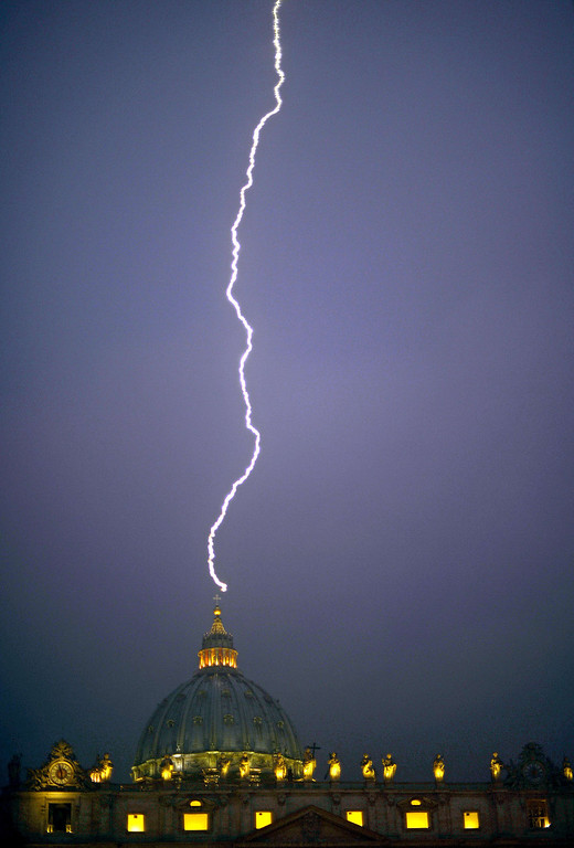 Description of . Lightning strikes St Peter's dome at the Vatican on February 11, 2013. Pope Benedict XVI announced he would resign as leader of the world's 1.1 billion Catholics on February 28 because his age prevented him from carrying out his duties -- an unprecedented move in the modern history of the Catholic Church.       FILIPPO MONTEFORTE/AFP/Getty Images