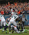 Earl Bennett #80 of the Chicago Bears flips over Bobby Wagner #54 and Kam Chancellor #31 of the Seattle Seahawks to score a touchdown at Soldier Field on December 2, 2012 in Chicago, Illinois.  (Photo by Jonathan Daniel/Getty Images)