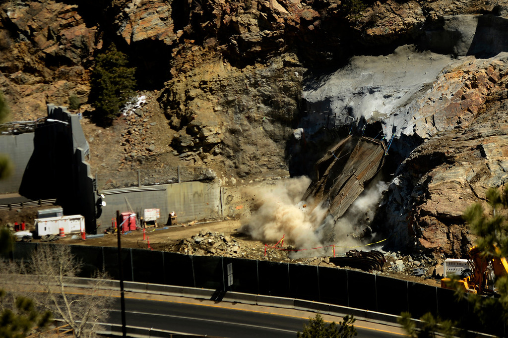 """. IDAHO SPRINGS, CO. - May 03: About 22,000 pounds of steel covering is blown out along with the solid rock as the first \""""blast\"""" at the west portal of the Twin Tunnels project in Idaho Springs signals the start the blasting season May 03, 2013 Idaho Springs, Colorado. (Photo By Joe Amon/The Denver Post)"""