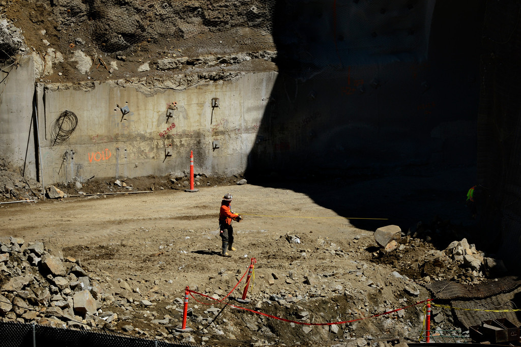 """. IDAHO SPRINGS, CO. - May 03:  Explosives worker pulling the cord before the first \""""blast\"""" at the west portal of the Twin Tunnels project in Idaho Springs that will signal the start the blasting season May 03, 2013 Idaho Springs, Colorado. (Photo By Joe Amon/The Denver Post)"""
