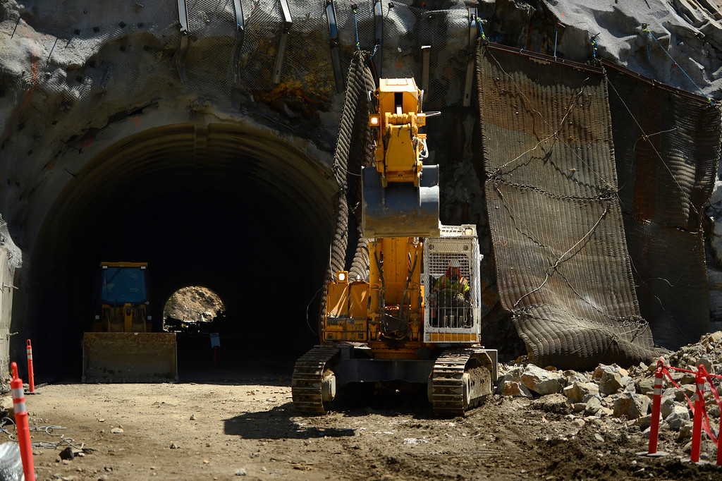""". IDAHO SPRINGS, CO. - May 03:  Machine operators go after the rubble after the first \""""blast\"""" at the west portal of the Twin Tunnels project in Idaho Springs May 03, 2013 Idaho Springs, Colorado. (Photo By Joe Amon/The Denver Post)"""