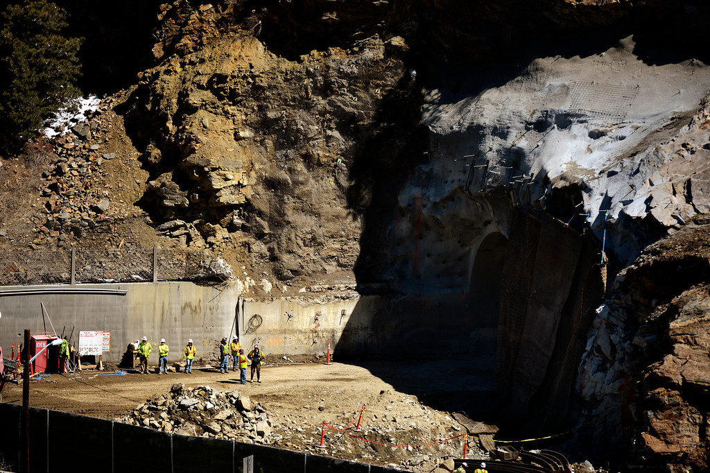 """. IDAHO SPRINGS, CO. - May 03: Workers wait for the inspectors to signal all is well before the first \""""blast\"""" at the west portal of the Twin Tunnels project in Idaho Springs that will signal the start the blasting season May 03, 2013 Idaho Springs, Colorado. (Photo By Joe Amon/The Denver Post)"""