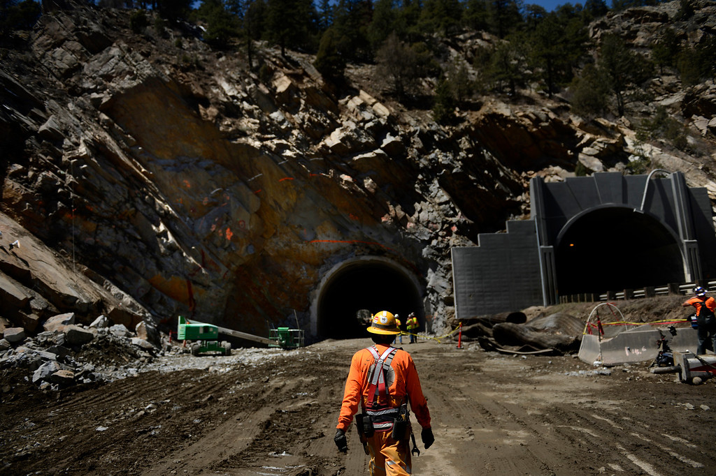 . IDAHO SPRINGS, CO. - May 03: A worker heads to his side of the tunnel at the east portal of the Twin Tunnels project in Idaho Springs. The project has shifts working 24 hours a day 6 days a week and the crews are tunneling from both ends May 03, 2013 Idaho Springs, Colorado. (Photo By Joe Amon/The Denver Post)