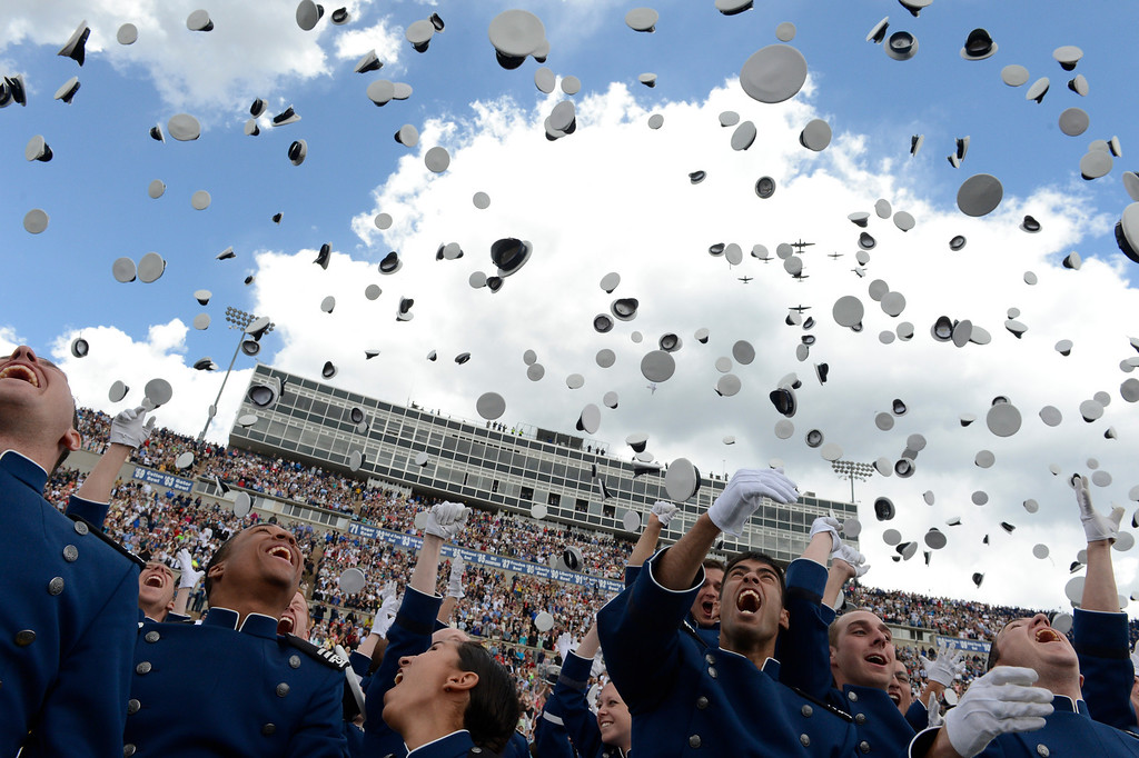 . Graduates toss their caps in the air as World War II aircrafts fly over head during the United States Air Force Academy graduation ceremony at Falcon Stadium in Colorado Springs, CO May 29, 2013.(Photo By Craig F. Walker/The Denver Post)