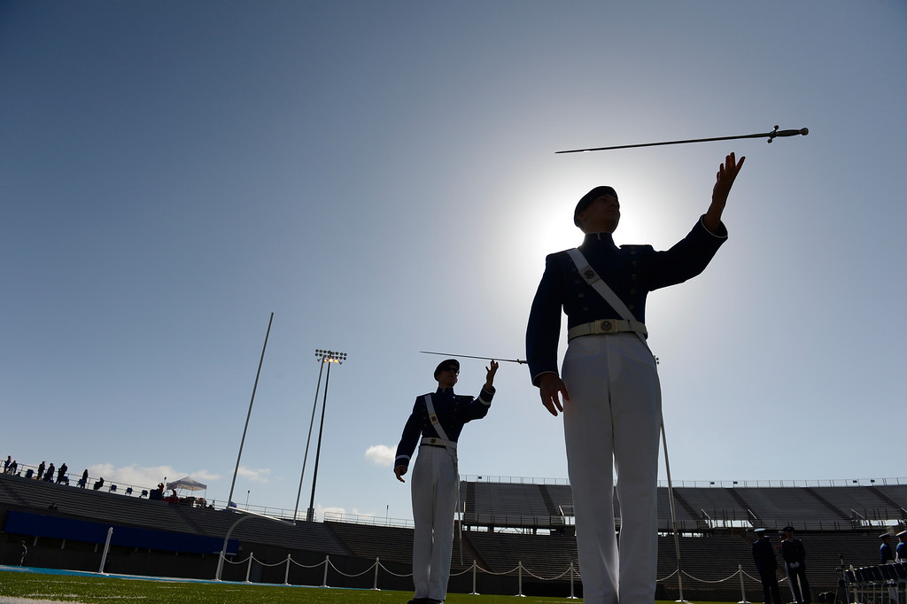 . Cadet Zach Morrow and the Sabre Drill Team entertain the crowd before the United States Air Force Academy graduation ceremony at Falcon Stadium in Colorado Springs, CO May 29, 2013.(Photo By Craig F. Walker/The Denver Post)