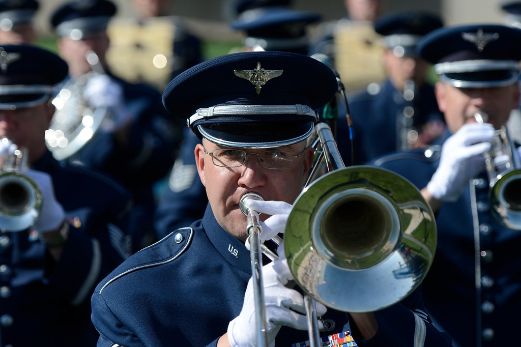 . SSgt. Frank Gourley plays the trombone with the Academy band during the United States Air Force Academy graduation ceremony at Falcon Stadium in Colorado Springs, CO May 29, 2013.(Photo By Craig F. Walker/The Denver Post)