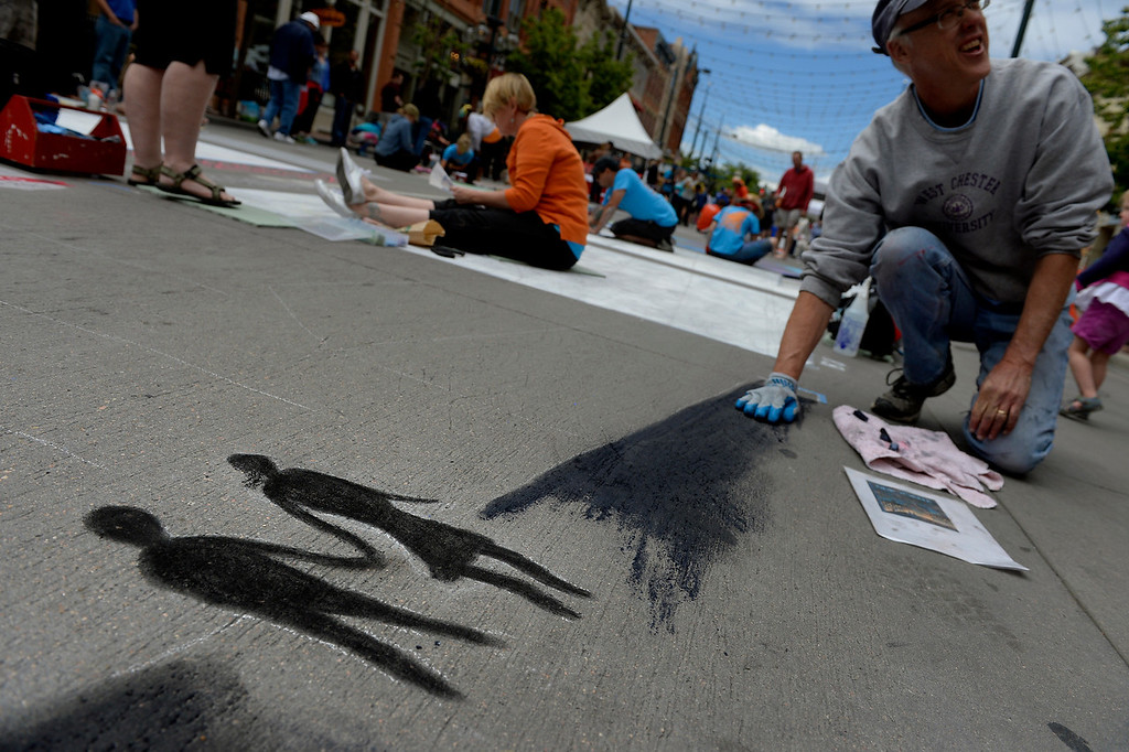 . DENVER, CO. - JUNE 01: Rick Roehm, of Lakewood, works on a reproduction of a New Yorker Magazine cover during the Denver Chalk Art Festival on Larimer Square in Denver, CO June 01, 2013. More than 200 artists took part in the annual event which continues Sunday. The festival features six award winning professionals  and a Youth Challenge presented by the Rocky Mountain College of Art & Design. (Photo By Craig F. Walker/The Denver Post)