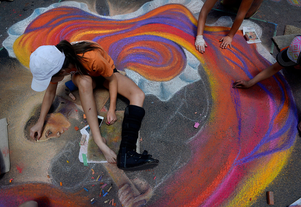 . DENVER, CO. - JUNE 01: Taylor Schofield and her classmates from Highlands Ranch High School work on a dance piece during the Denver Chalk Art Festival on Larimer Square in Denver, CO June 01, 2013. More than 200 artists took part in the annual event which continues Sunday. The students were taking part in a Youth Challenge presented by the Rocky Mountain College of Art & Design. (Photo By Craig F. Walker/The Denver Post)
