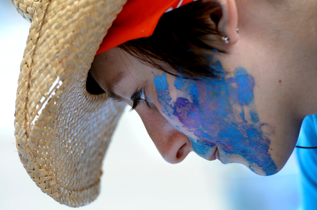 . DENVER, CO. - JUNE 01: Olivia McLeod, of Wheat Ridge, works on an original piece, during the Denver Chalk Art Festival on Larimer Square in Denver, CO June 01, 2013. More than 200 artists took part in the annual event which continues Sunday. The festival features six award winning professionals  and a Youth Challenge presented by the Rocky Mountain College of Art & Design. (Photo By Craig F. Walker/The Denver Post)