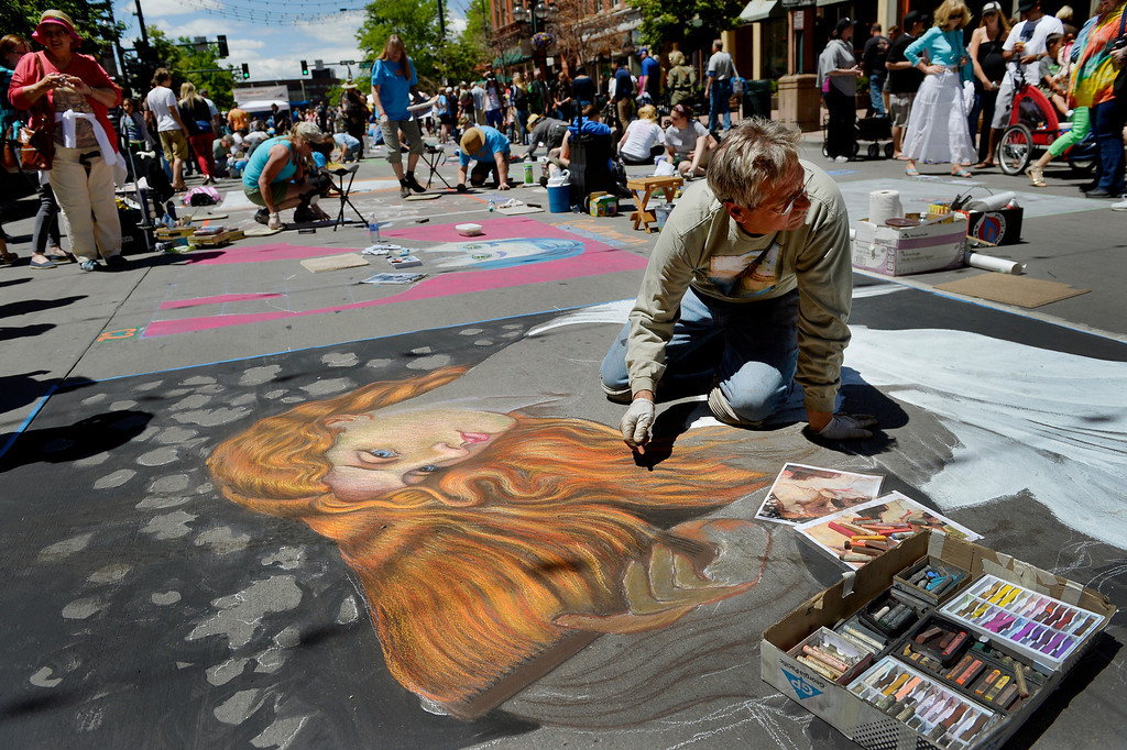 """. DENVER, CO. - JUNE 01: Westminster artist Stephen DeOrio works on a reproduction of \""""Lady Lilith,\"""" originally painted by Dante Gabriel Rossetti, during the Denver Chalk Art Festival on Larimer Square in Denver, CO June 01, 2013. More than 200 artists took part in the annual event which continues Sunday. The festival features six award winning professionals  and a Youth Challenge presented by the Rocky Mountain College of Art & Design. (Photo By Craig F. Walker/The Denver Post)"""