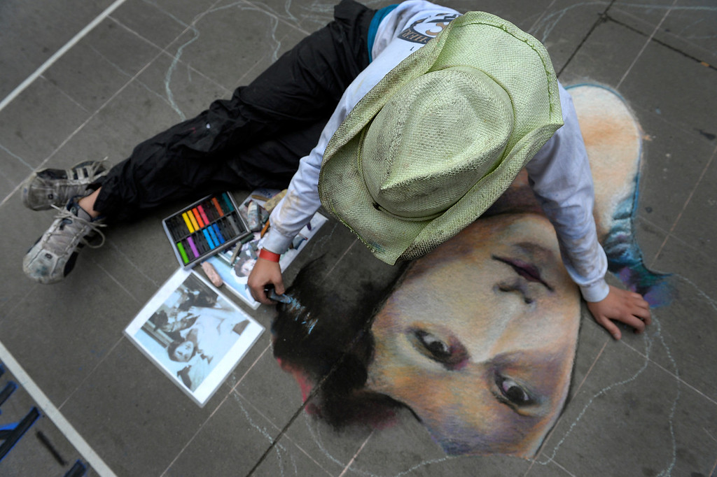 . DENVER, CO. - JUNE 01: Grace Hollenbeck of Denver, works on a drawing of her great grandmother during the Denver Chalk Art Festival on Larimer Square in Denver, CO June 01, 2013. More than 200 artists took part in the annual event which continues Sunday. The festival features six award winning professionals  and a Youth Challenge presented by the Rocky Mountain College of Art & Design. (Photo By Craig F. Walker/The Denver Post)