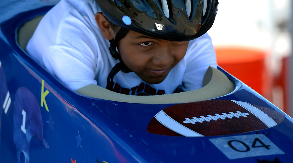 . KJ Morgan car #4 eyes the track ahead of him before his race at the Seventh Annual Sertoma Mile High Soap Box Derby June 9, 2013 in its first year at their new location at Arapahoe County Fair Grounds. The Sertoma Club, a non-profit international organization helps many of the estimated 50 million Americans with speech and hearing disorders. (Photo By John Leyba/The Denver Post)