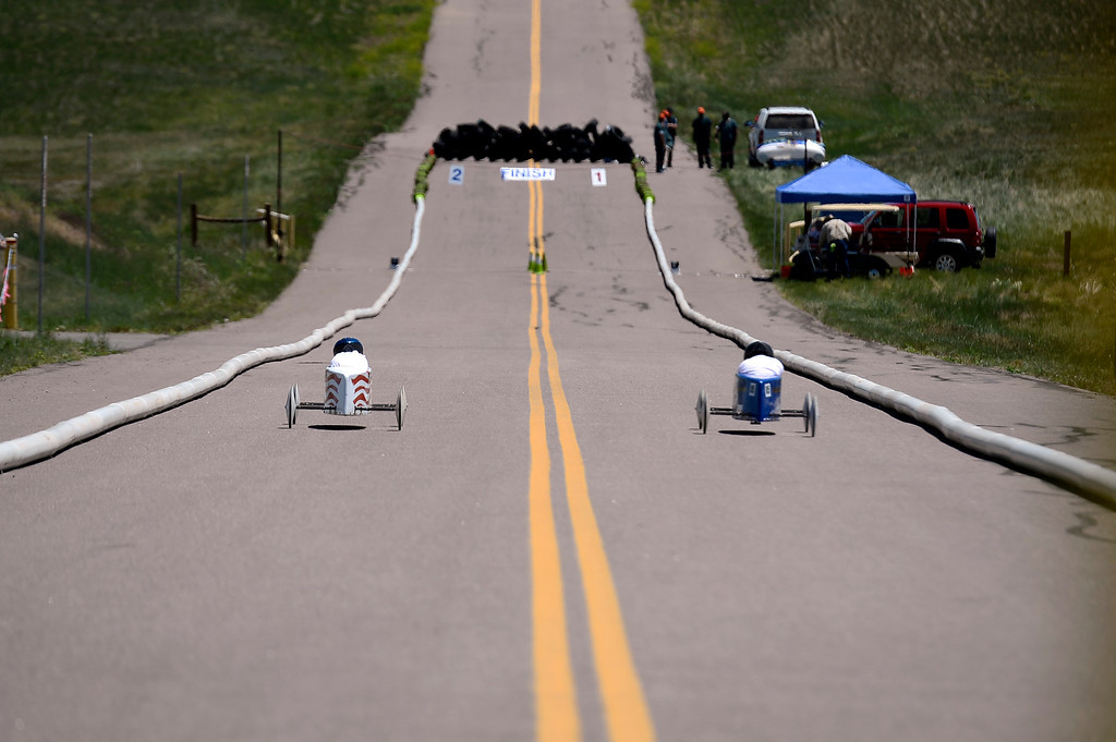 . Racers head down the hill during the Seventh Annual Sertoma Mile High Soap Box Derby June 9, 2013 in its first year at their new location at Arapahoe County Fair Grounds. The Sertoma Club, a non-profit international organization helps many of the estimated 50 million Americans with speech and hearing disorders. (Photo By John Leyba/The Denver Post)