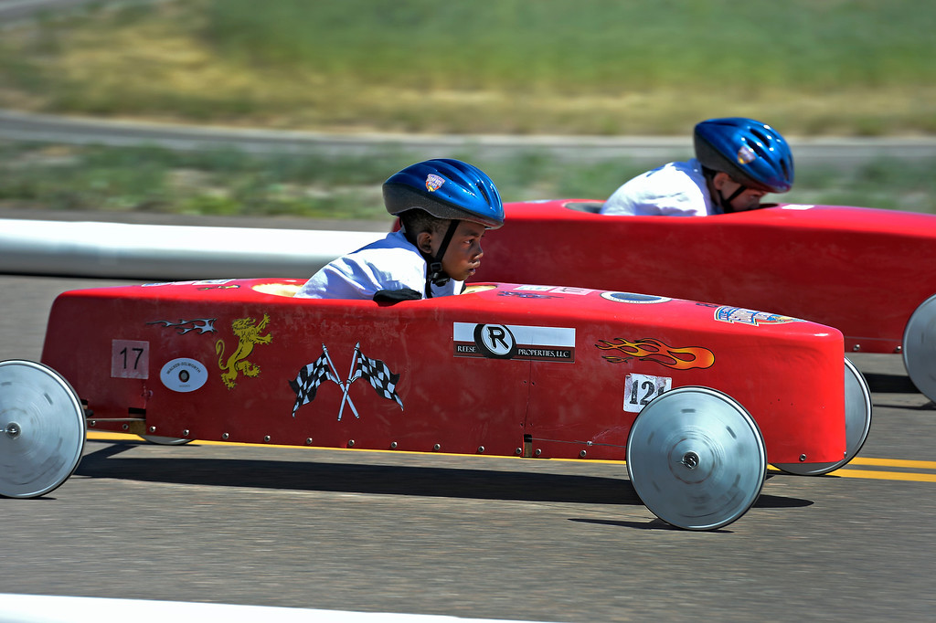 . Vishnu Gonzales car #17 heads down the track during his race against Lance Goethals car #19 at the Seventh Annual Sertoma Mile High Soap Box Derby June 9, 2013 in their first year at their new location at Arapahoe County Fair Grounds. The Sertoma Club, a non-profit international organization helps many of the estimated 50 million Americans with speech and hearing disorders. (Photo By John Leyba/The Denver Post)