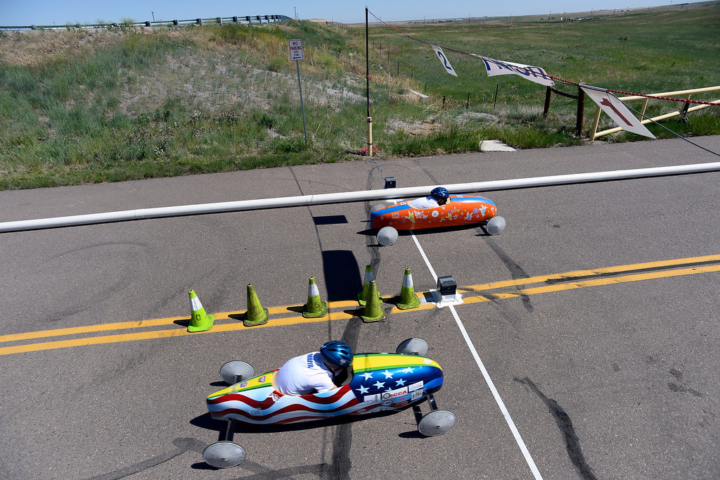 . Clare Mahoney car #104 edges out Andrea Perkins at the finish line during The Seventh Annual Sertoma Mile High Soap Box Derby June 9, 2013 in its first year at their new location at Arapahoe County Fair Grounds. The Sertoma Club , a non-profit international organization helps many of the estimated 50 million Americans with speech and hearing disorders.  (Photo By John Leyba/The Denver Post)