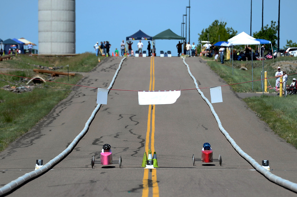 . Racers head down the track during their race at the Seventh Annual Sertoma Mile High Soap Box Derby June 9, 2013 in their first year at their new location at Arapahoe County Fair Grounds. The Sertoma Club, a non-profit international organization helps many of the estimated 50 million Americans with speech and hearing disorders. (Photo By John Leyba/The Denver Post)