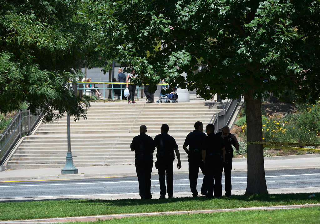 ". Authorities investigate a crime scene on Colfax Avenue after a shooting between Broadway and Lincoln Street near the Colorado Capitol Thursday morning in Denver, CO August 15, 2013. Three people are in custody and a gun has been recovered, no injuries were reported. Witnesses described the incident as a ""shootout\"" between two people, but police could not confirm that. (Photo By Craig F. Walker / The Denver Post)"