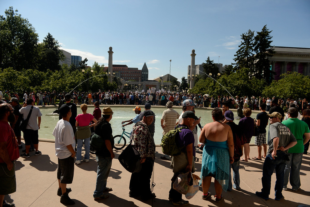 . Hundreds of pro cannabis supporters line up for a free marijuana joint during a rally at Denver Civic Center Park, September 09, 2013. The joint handout is a demonstration to oppose new tax increases on marijuana. (Photo By RJ Sangosti/The Denver Post)