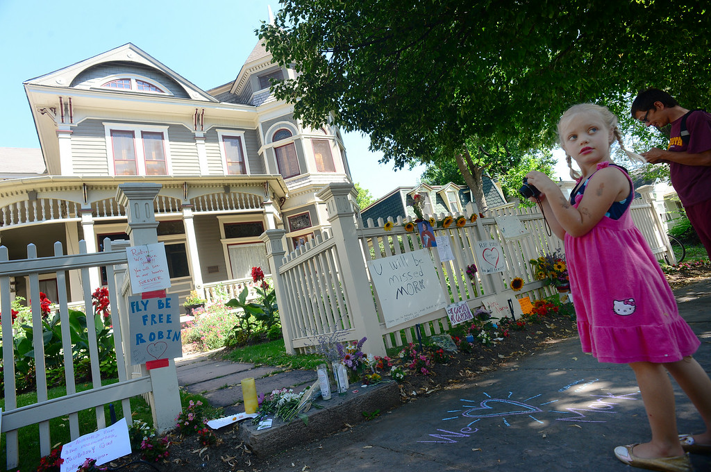 . Raleigh Hunnicutt, 5, gets ready to take a picture of all of the flowers, notes, cards, pictures, candles and drawings left in front of the Mork and Mindy house at 1619 Pine Street in Boulder, CO on August 12, 2014.  (Photo By Helen H. Richardson / The Denver Post)
