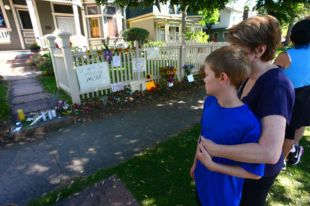 . Pat Vidulich and her grandson Dario McCormick, 12,  gather in front of the Mork and Mindy house at 1619 Pine Street in Boulder, CO on August 12, 2014 to pay their respects to Robin Williams who died of an apparent suicide at his home in California.   (Photo By Helen H. Richardson / The Denver Post)