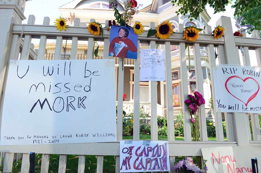 . Flowers, cards, photos, candles and notes are left on the front white picket fence of the Mork and Mindy house at 1619 Pine Street in Boulder, CO on August 12, 2014 for Robin Williams who died of an apparent suicide at his home in California.  (Photo By Helen H. Richardson / The Denver Post)