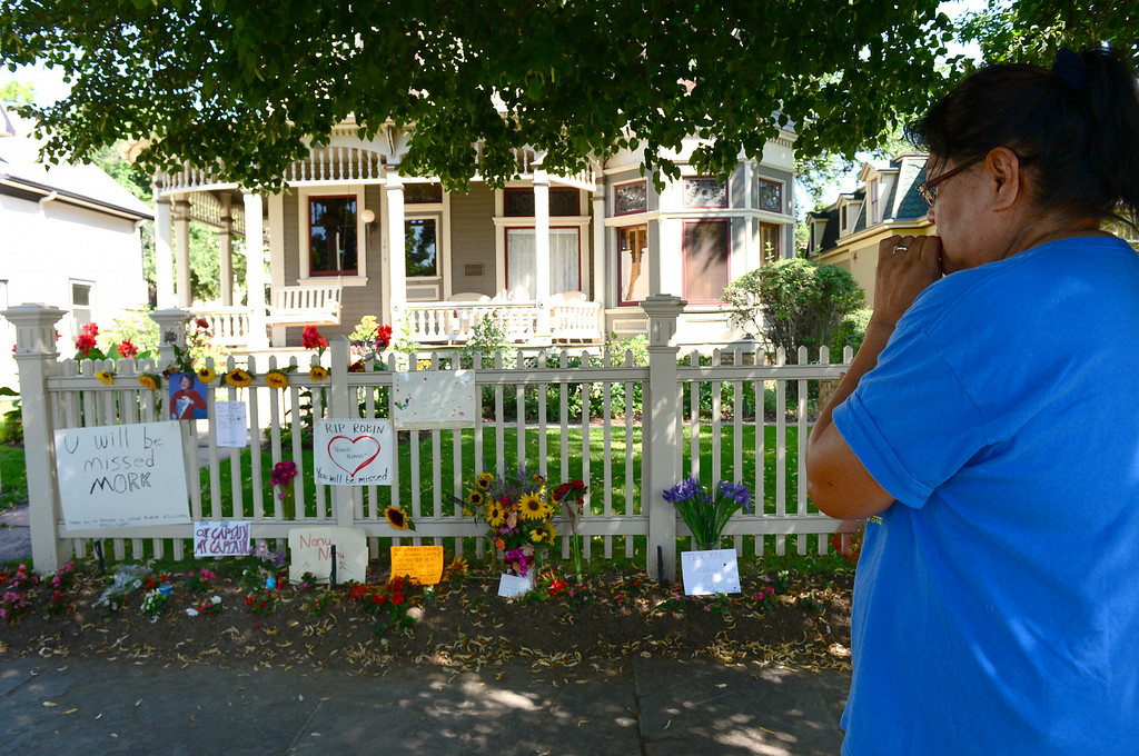 . Ruby Wildcat reflects for a moment in front of the Mork and Mindy house at 1619 Pine Street in Boulder, CO on August 12, 2014.  She and many others turned out to pay their respects to Robin Williams who died of an apparent suicide at his home in California.  (Photo By Helen H. Richardson / The Denver Post)