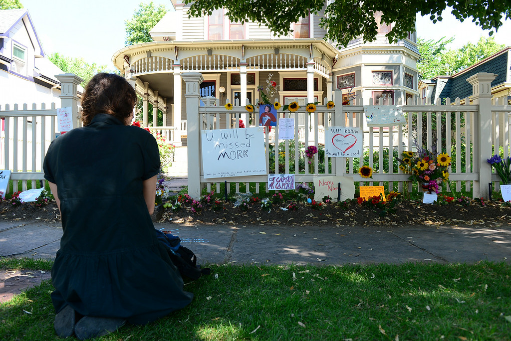 . Ashleigh Jai Hitchcock, sits quietly near the side walk outside in front of the Mork and Mindy house at 1619 Pine Street in Boulder, CO on August 12, 2014.    (Photo By Helen H. Richardson / The Denver Post)