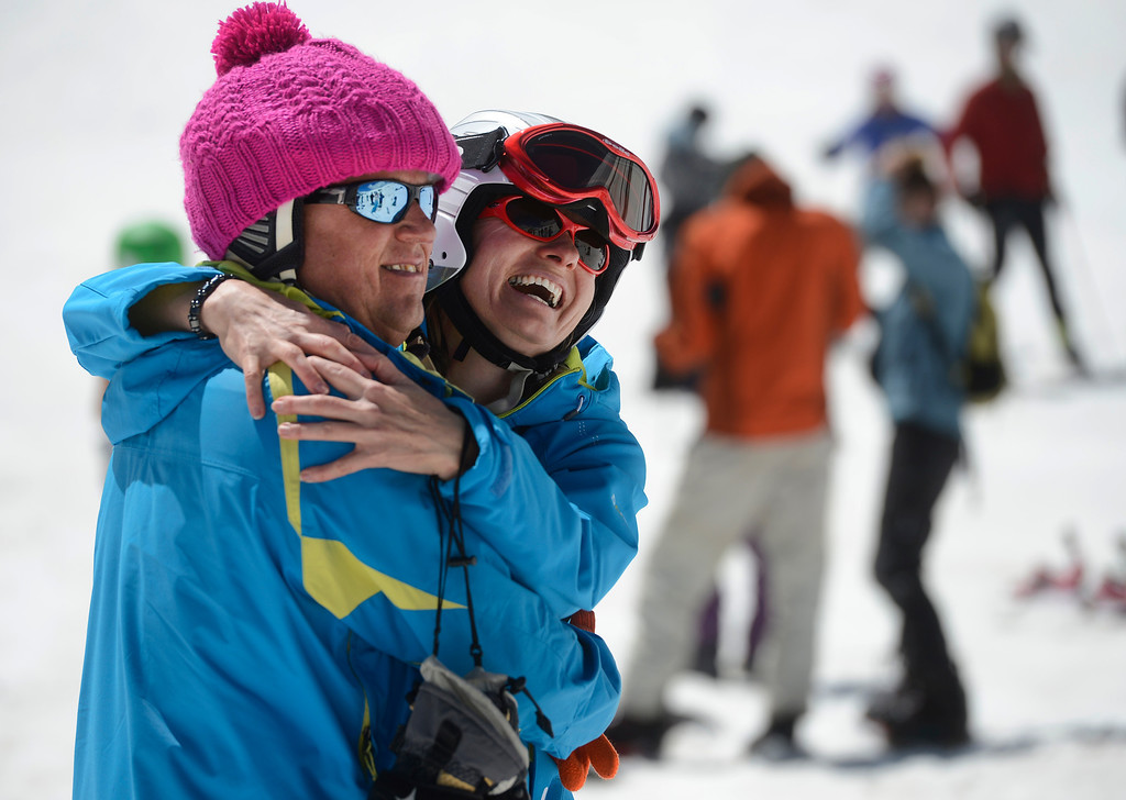 . SUMMIT COUNTY, CO - JUNE 08: Good friends, Michael Fales, left, and Dagmar Teleky, have a laugh together as a friend takes their picture at the Arapahoe Basin ski area in Summit County Colorado, Saturday morning, June 08, 2013. The ski area will close for the season at the end of the day, Sunday June 09, 2013.  (Photo By Andy Cross/The Denver Post)