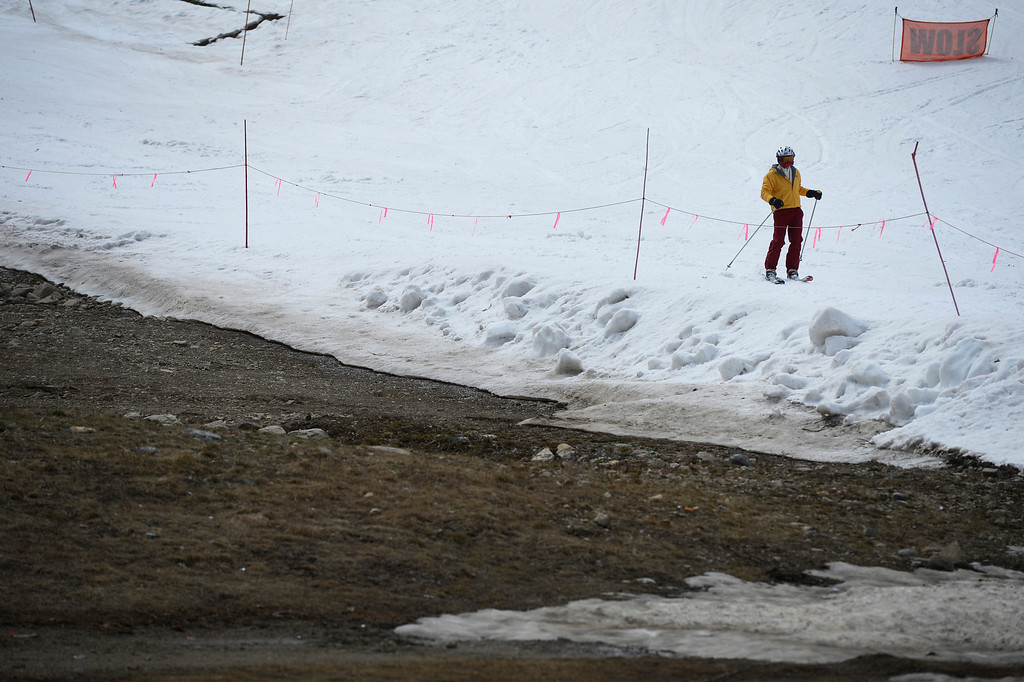 . SUMMIT COUNTY, CO - JUNE 08: A skier makes their way down the Wrangler ski trail at the Arapahoe Basin ski area in Summit County Colorado, Saturday morning, June 08, 2013. The ski area will close for the season at the end of the day, Sunday June 09, 2013.  (Photo By Andy Cross/The Denver Post)