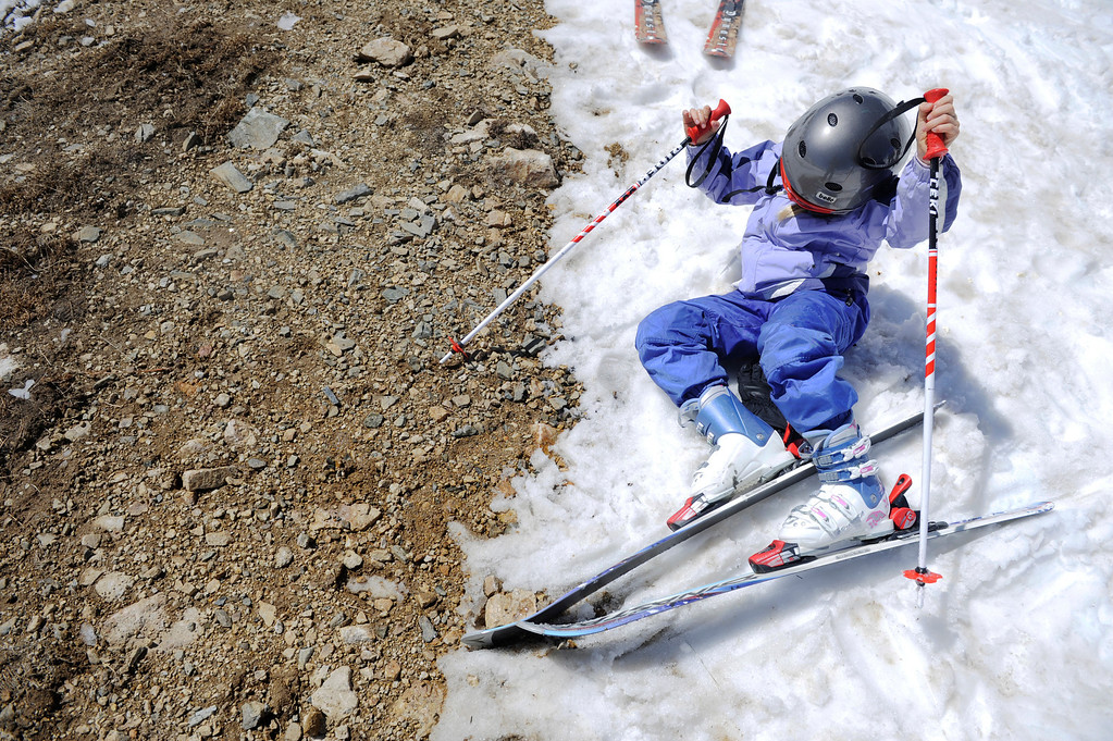 . SUMMIT COUNTY, CO - JUNE 08: Amanda Liedtke, 8, tries to push herself back up on her skis at the Arapahoe Basin ski area in Summit County Colorado, Saturday morning, June 08, 2013.  The ski area will close for the season at the end of the day, Sunday June 09, 2013.  (Photo By Andy Cross/The Denver Post)