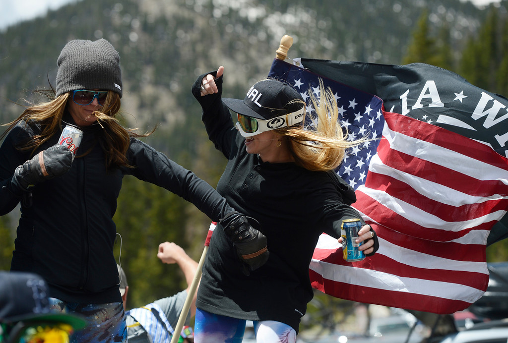 . SUMMIT COUNTY, CO - JUNE 08: Good friends Tammy Kluber, left, and Kellie Kenley, dance in the back of a pick-up truck in the parking lot of the Arapahoe Basin ski area in Summit County Colorado, Saturday morning, June 08, 2013 celebrating the second to last day of the season at Arapahoe Basin. The ski area will close for the season at the end of the day, Sunday June 09, 2013.  (Photo By Andy Cross/The Denver Post)