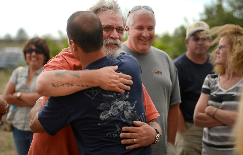 . BLACK FOREST, CO - JUNE 16: Black Forest homeowner Scott Riebel gives El Paso County Sheriff Terry Maketa a hug after Maketa spoke privately with evacuees after the daily press briefing for the media at Pikes Peak Community College Rampart Range Campus near Monument, CO  on June 16, 2013. He wanted to personally take the time to answer all and any questions that residents had. Photo by Helen H. Richardson/The Denver Post)