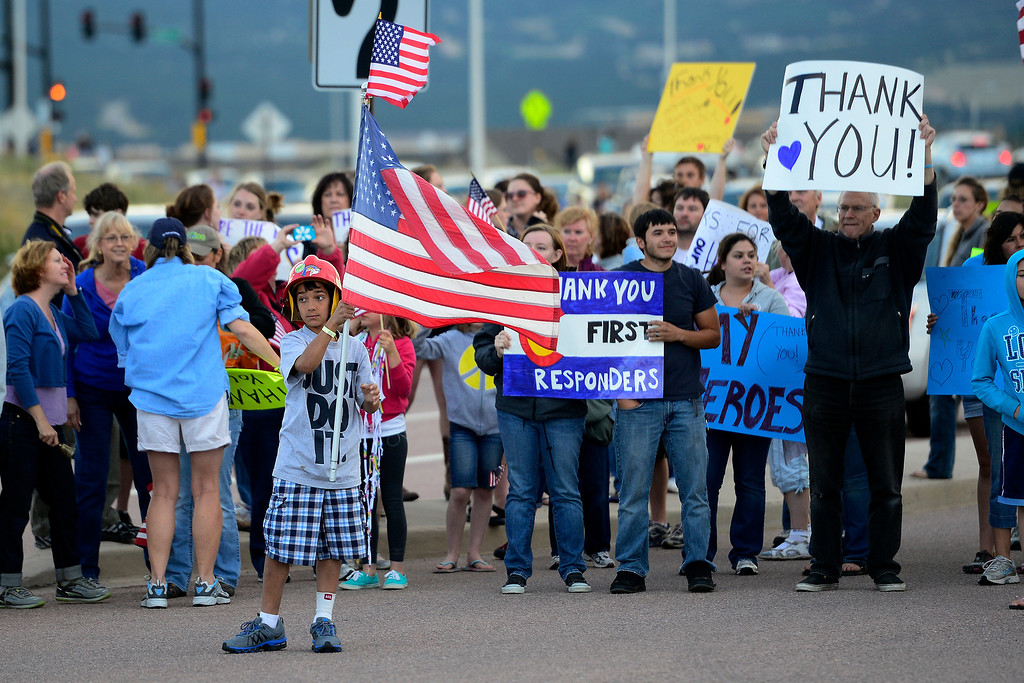 . Crowds welcome fire crews and other public officials back to the incident command post at Pine Creek High School as shifts change. Crews continued to fight the Black Forest Fire into Sunday evening as rains and cool weather set in. (Photo by AAron Ontiveroz/The Denver Post)