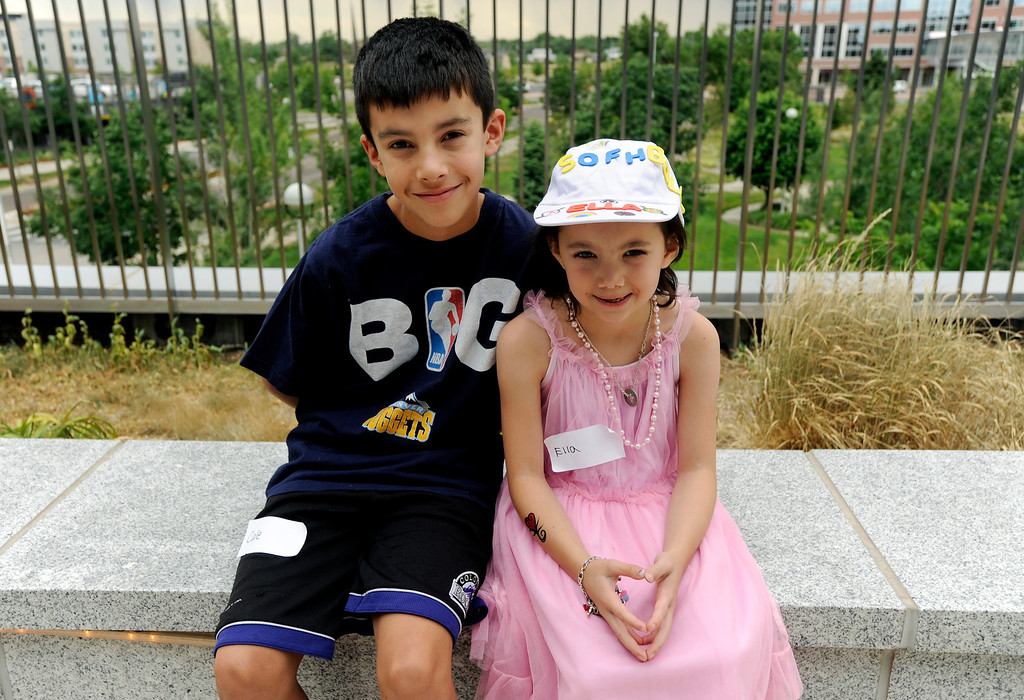 """. Cale Weigel, 11, left, poses with his sister, Ella, 7, during Children\'s Hospital Colorado\'s \""""Take Me Out to the Ballgame\"""" cancer survivor\'s event on June 23, National Cancer Survivors\' Day, at the Children\'s Hospital in Aurora, Colo. Ella, who was diagnosed with myelodysplastic syndrome (MDS - a condition in which blood-forming cells in the bone marrow are damaged), received a bone-marrow transplant from Cale over a year ago, and she has been in remission since. \""""It hurt, and it was scary for us both,\"""" Cale said. Photo by Jamie Cotten, Special to The Denver Post"""