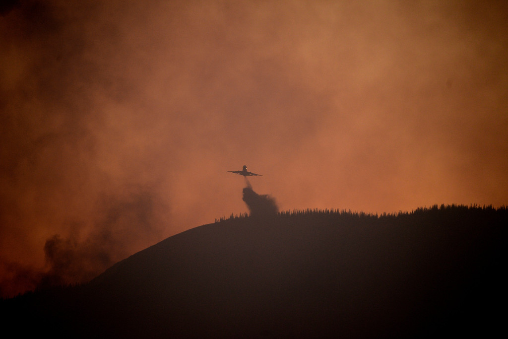 . CREEDE, CO - JUNE 25: A plane flies drops slurry as the Papoose fire continues to burn at sunset near Creede. The three fires that make up the West Fork Complex fire now top out at more than 70 thousand acres. (Photo by AAron Ontiveroz/The Denver Post)