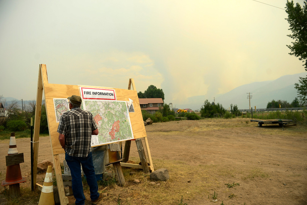 . A man looks at the fire map as the Papoose fire continues to burn near Creede. The three fires that make up the West Fork Complex fire now top out at more than 80 thousand acres. (Photo by AAron Ontiveroz/The Denver Post)