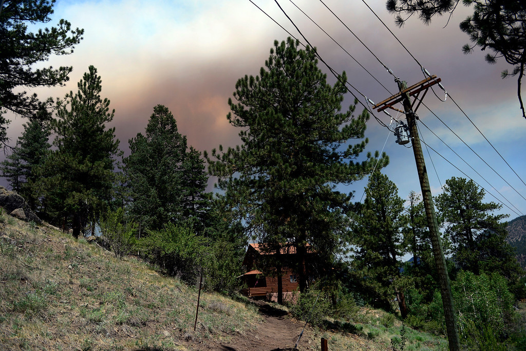 . A plume of smoke grows as wind speeds increase as the West Fork Fire continues to burn near South Fork. The West Fork Fire grew to more than 70,000 acres overnight. (Photo by AAron Ontiveroz/The Denver Post)