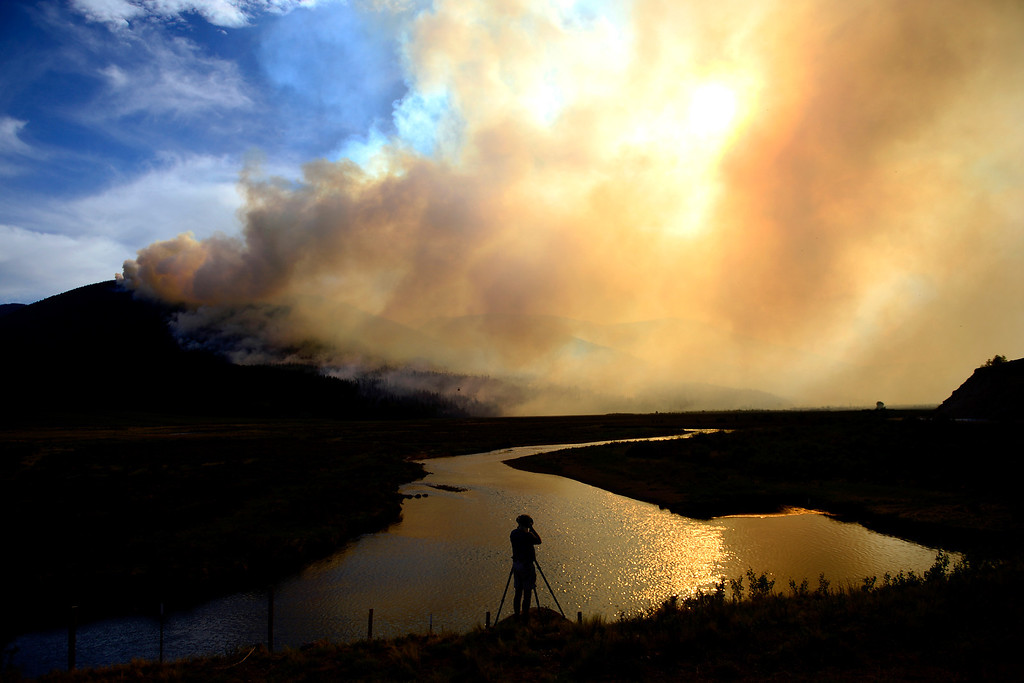. Joe Zinn photographs the scene as the West Fork Fire continues to burn near Creede, Colorado. The West Fork Fire grew to more than 70,000 acres overnight. (Photo by AAron Ontiveroz/The Denver Post)