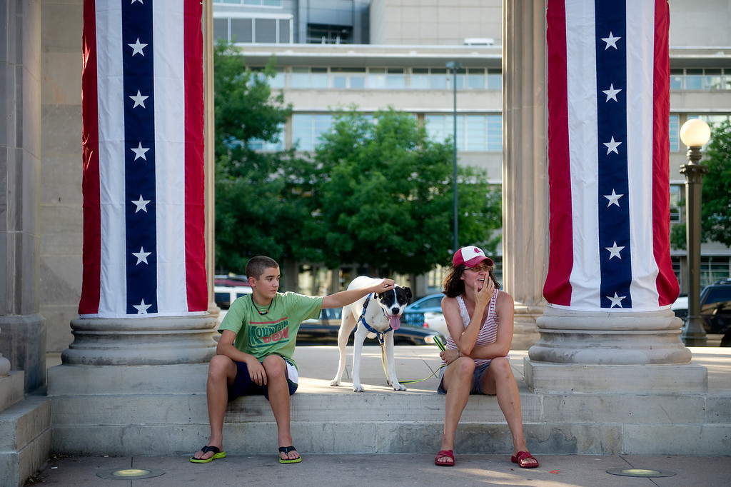 . DENVER - JULY 3: Cody Punch, 12, his mother, Amy Punch and their dog Cody wait for the fireworks and the Colorado Symphony for an Independence Day Celebration at Civic Center Park in Denver on July 3, 2013. (Photo By Grant Hindsley/The Denver Post)