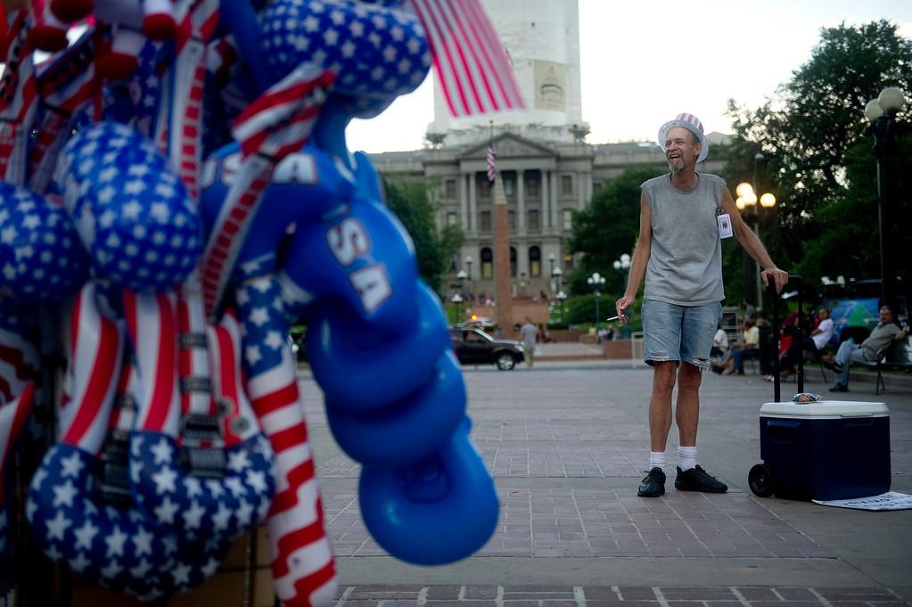 . DENVER - JULY 3: Scott Sanders laughs while talking to a vendor at Civic Center Park in Denver on July 3, 2013. (Photo By Grant Hindsley/The Denver Post)