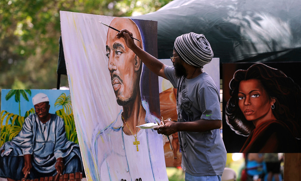 """. DENVER, CO - JULY13: Artist Azizi Abdalla works on a large painting during the festival. The 27th Annual Colorado Black Arts Festival takes place in City Park with this year\'s theme \""""African American Style: an American Legacy. The festival continues through Sunday with dozens of artists, vendors, and performances taking place. (Photo By Kathryn Scott Osler/The Denver Post)"""