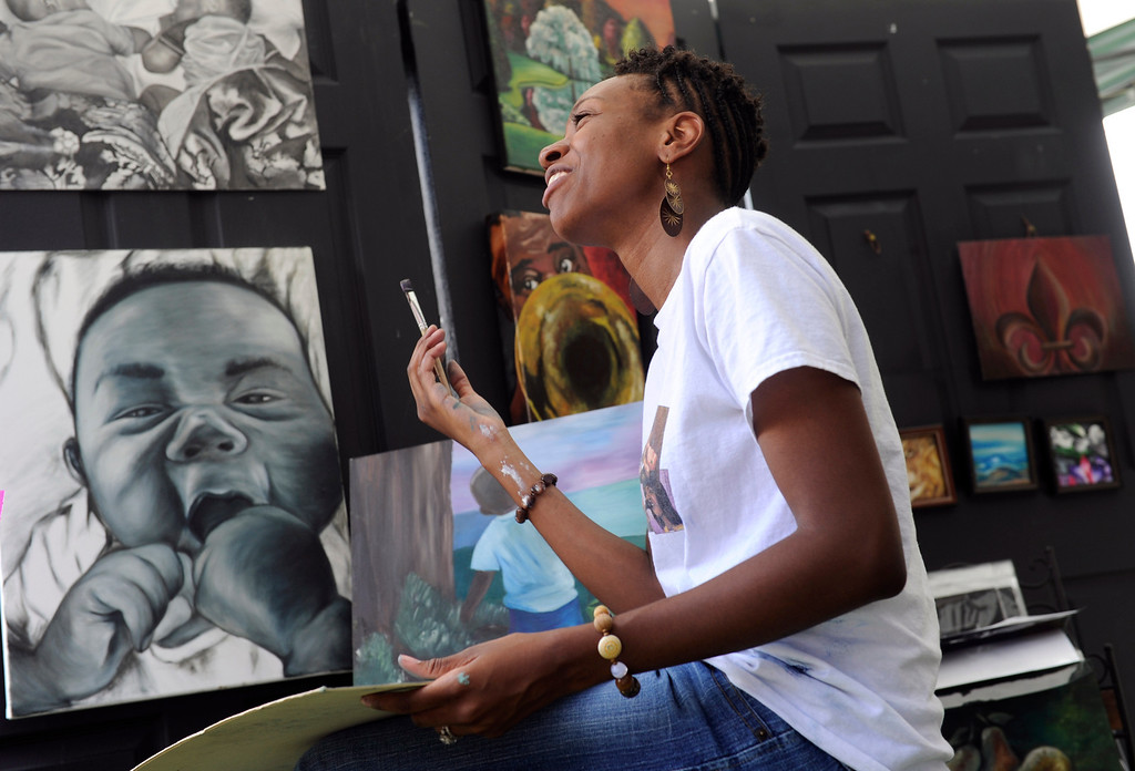 """. DENVER, CO - JULY13: Artist Letora Anderson works on one of her oil paintings during the festival. The 27th Annual Colorado Black Arts Festival takes place in City Park with this year\'s theme \""""African American Style: an American Legacy. The festival continues through Sunday with dozens of artists, vendors, and performances taking place. (Photo By Kathryn Scott Osler/The Denver Post)"""