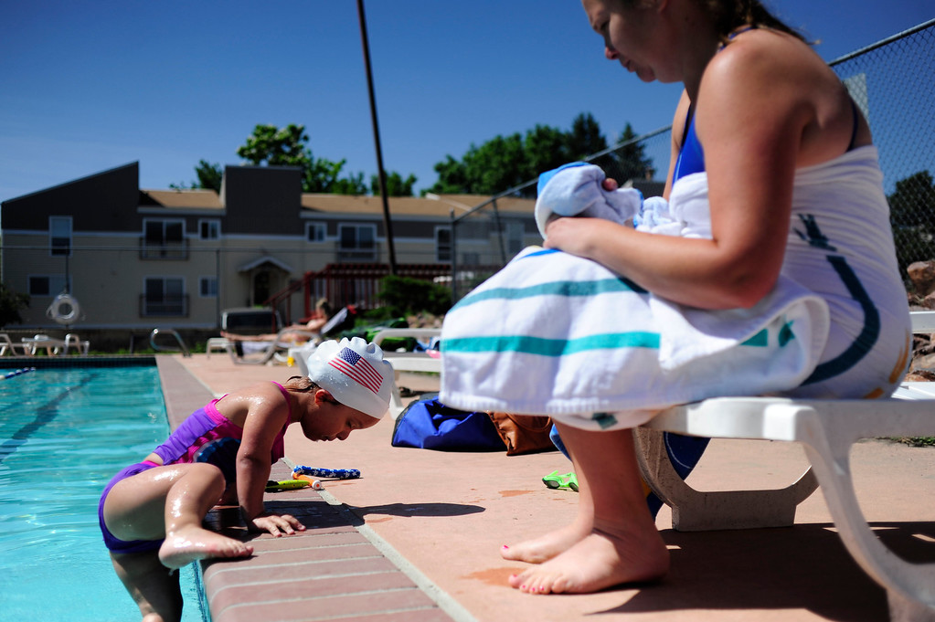 . DENVER - JUNE 19: Mia Towl, 9, climbs out of the pool to get a towel from her mother, Lyssa Towl, at Point Athletic Club on June 19, 2013. Towl swims three to four times a week and will soon start training everyday for the 2013 Dwarf Games in Lansing Michigan. (Photo By Grant Hindsley/The Denver Post)