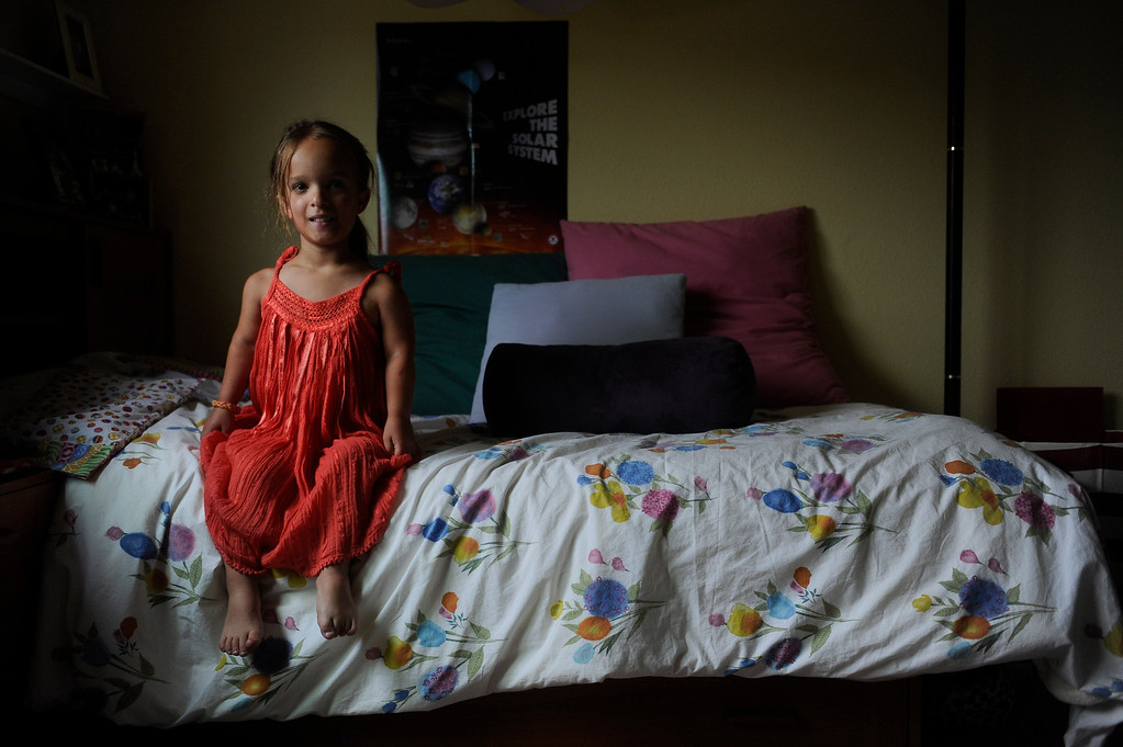 . GOLDEN, CO. - JUNE 22: Mia Towl, 9, poses for a portrait in her room on June 22, 2013. 
